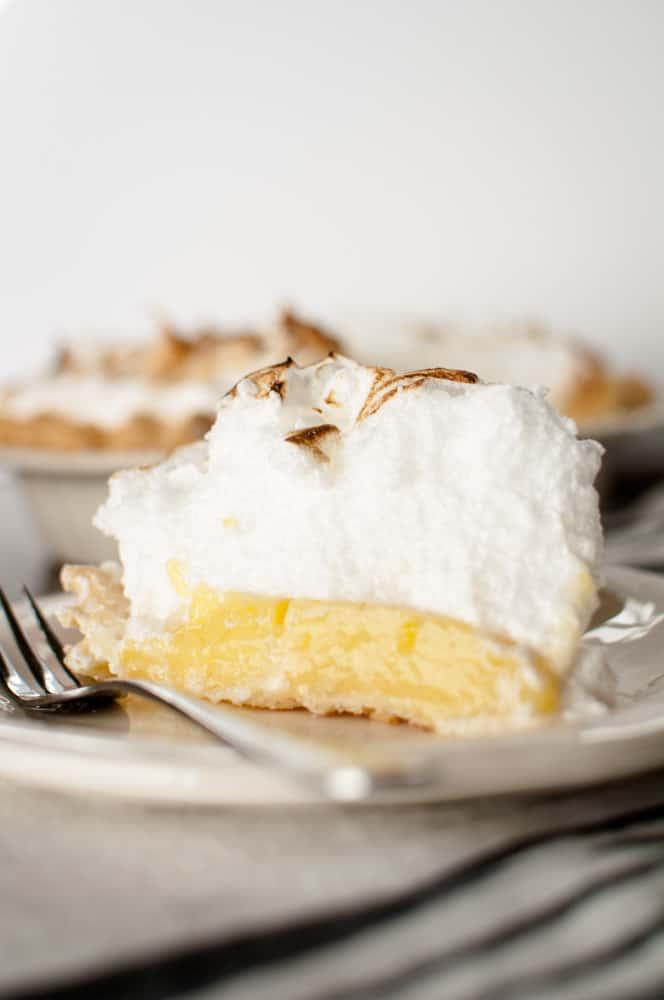 Slice of lemon meringue pie on a plate