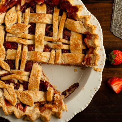 Gluten Free Strawberry Rhubarb Pie with one slice removed