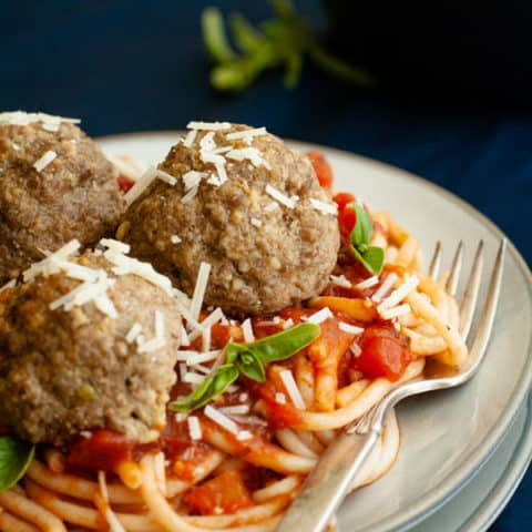 GLuten Free Spaghetti and Meatballs with parmesan and basil topping