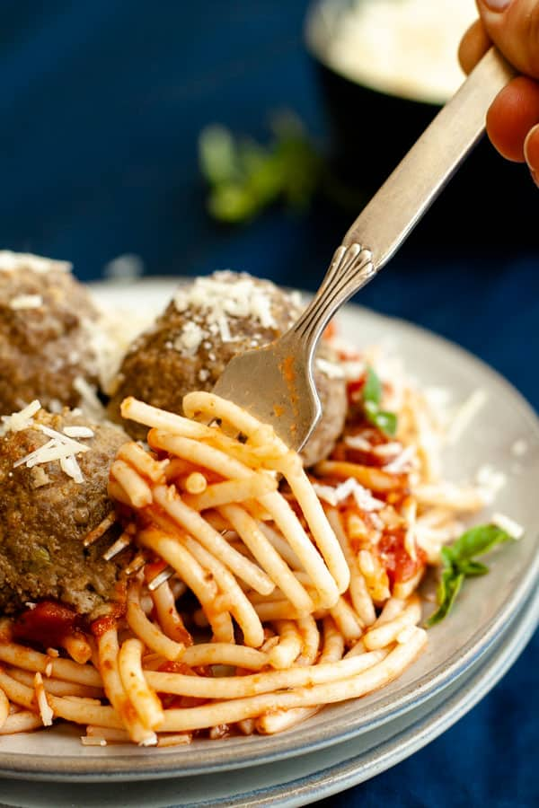 Gluten Free Spaghetti and Meatballs with noodles spinning around fork