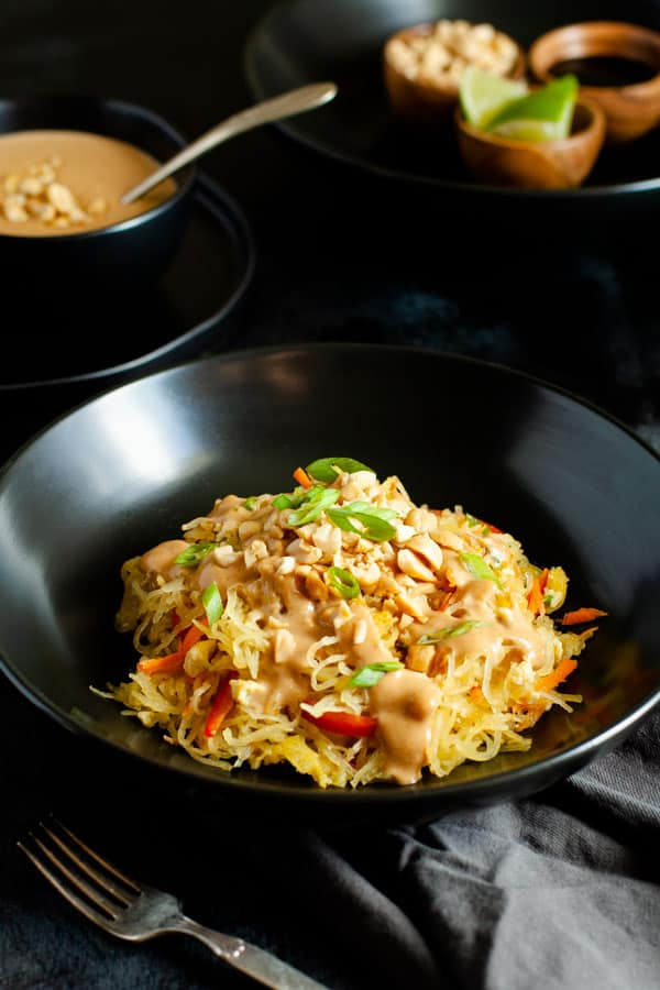 Spaghetti Squash Pad Thai topped with peanut sauce and crushed peanut garnish