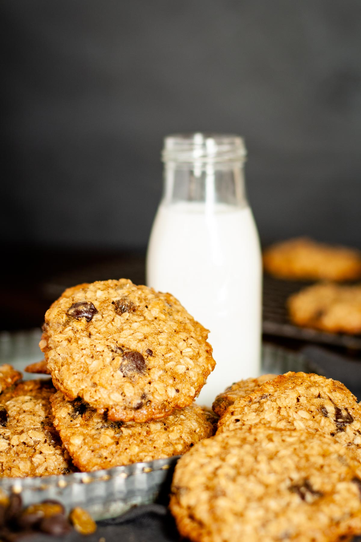 Golden Raisin Oatmeal cookies with chocolate chips in a stack next to milk