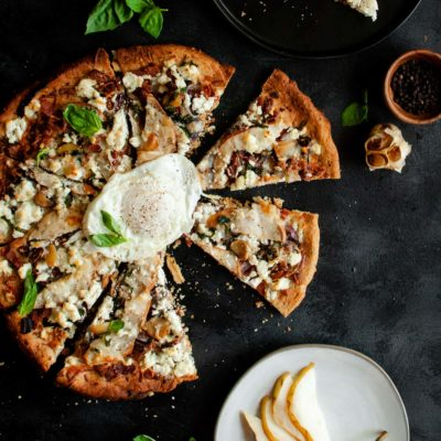pear & goat cheese pizza served with ove-reasy egg