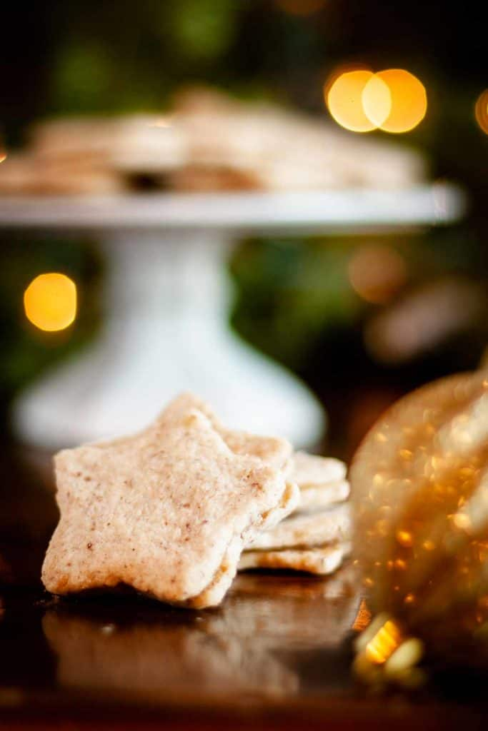 Close up of star cutout and filled pecan shortbread cookie