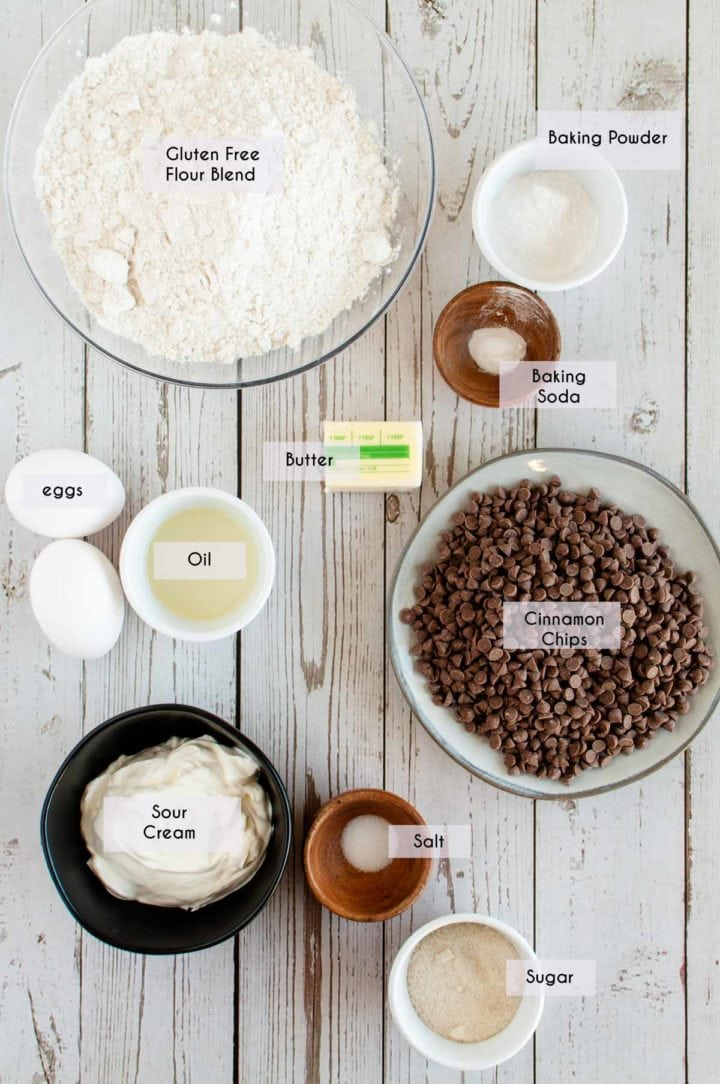 picture of ingredients needed for gluten free cinnamon scones laid out on white wooden surface