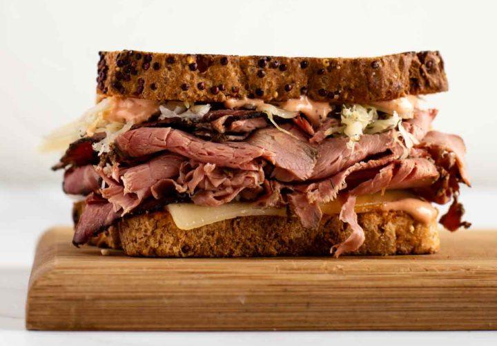 gluten free reuben sandwich displayed on cutting board