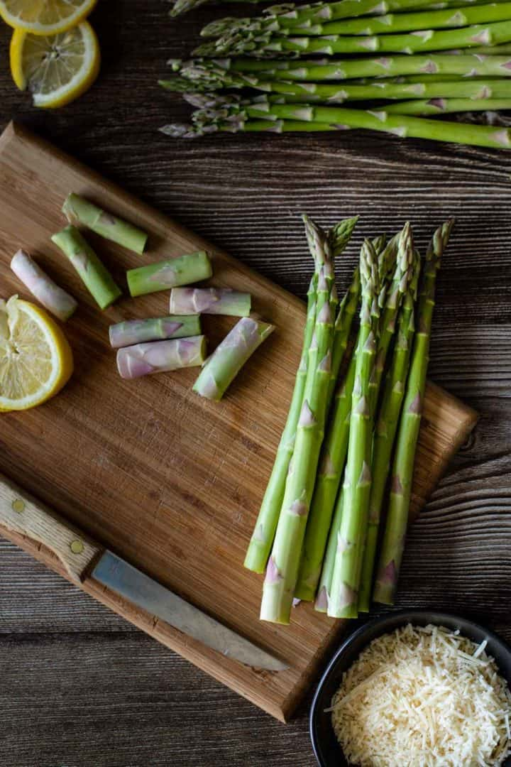 How to prepare asparagus for cooking, showing how to slice the ends off the asparagus stalks