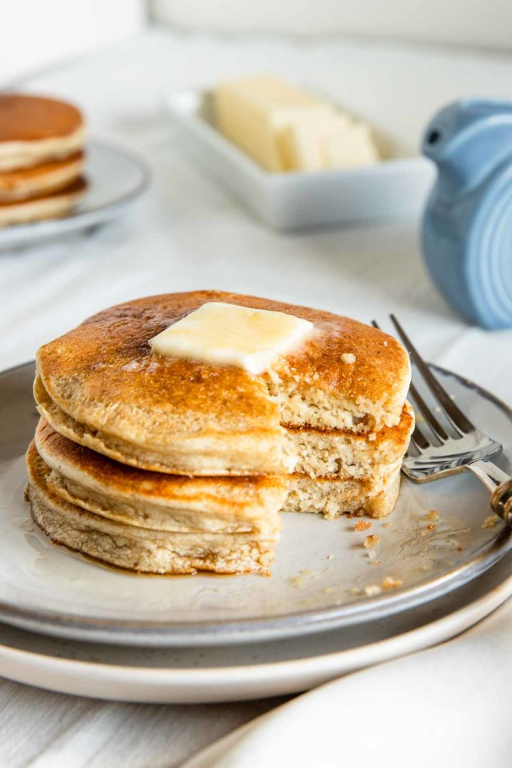 fluffy banana pancakes with a bite taken out of them