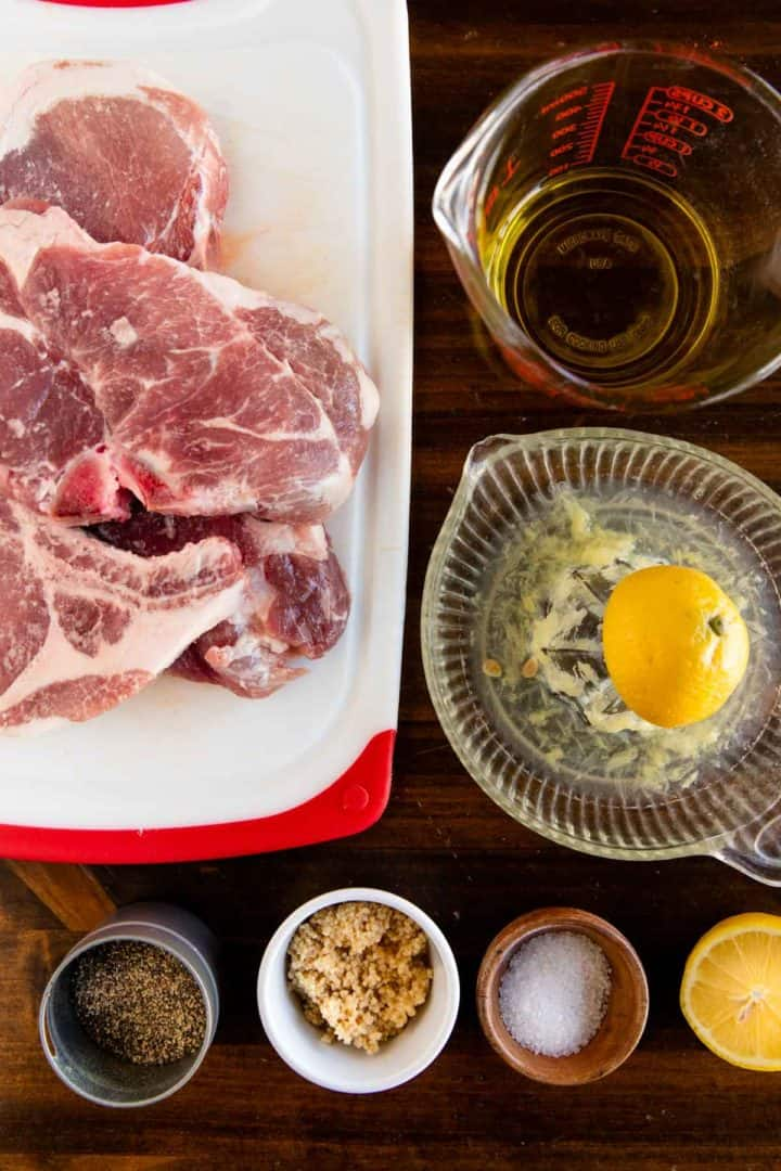 ingredients needed for honey bbq pork chops, laid out on wooden table