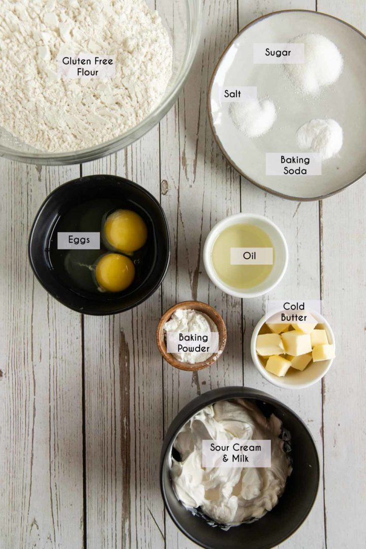 ingredients needed to make gluten free biscuits, displayed in dishes on white wooden table